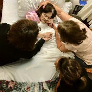 sisters beside bedside of mother